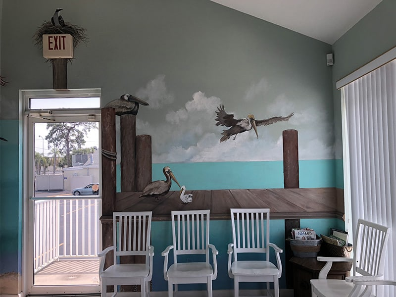 One of the murals inside the clinic and the waiting area. The mural is of a five different sea birds on a boardwalk